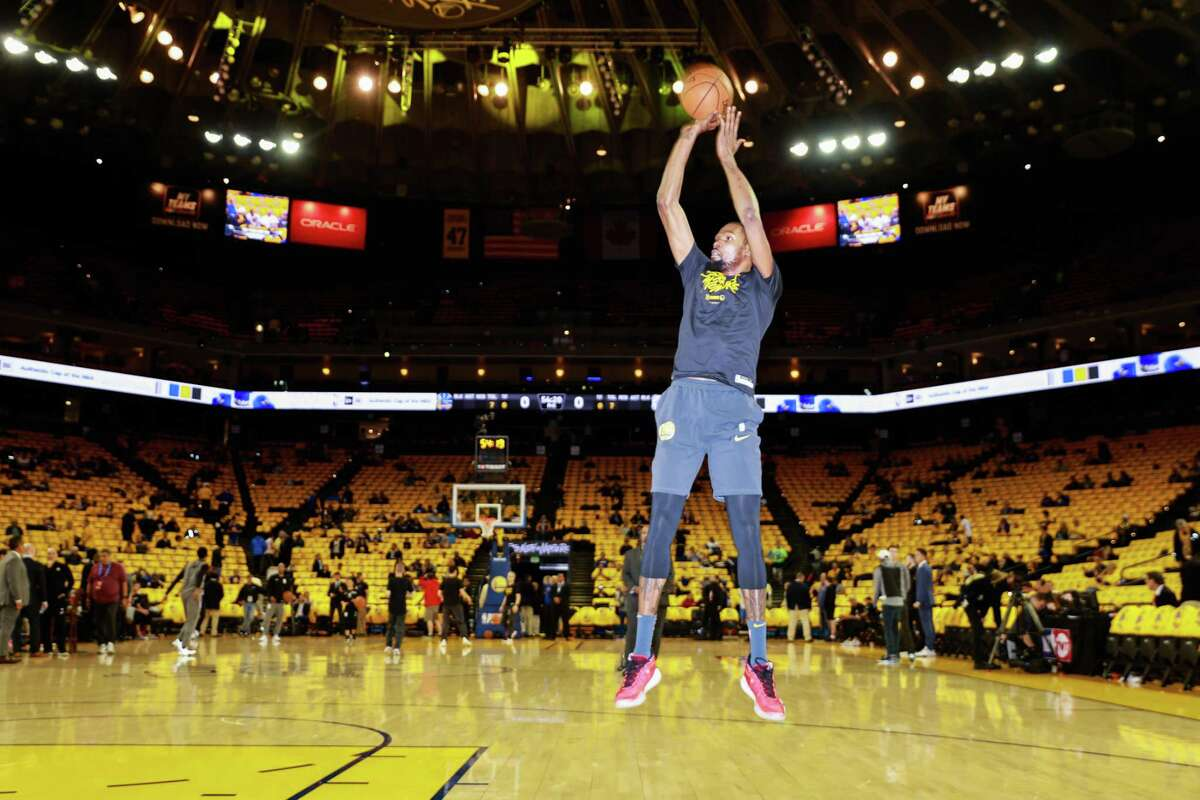 Warriors' Kevin Durant takes a shot during warmups ahead of Game 2 of a playoff series against the Los Angeles Clippers.