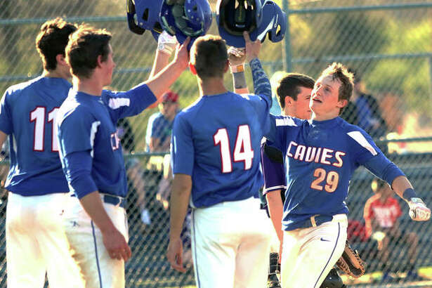 Carlinville's Aidan Naugle (29) is greeted at the plate after his grand slam drove home Sam Tieman (11), Colton DeLong and Lonny Rosentreter in the fourth inning of the Cavaliers' five-inning victory Tuesday at Litchfield.