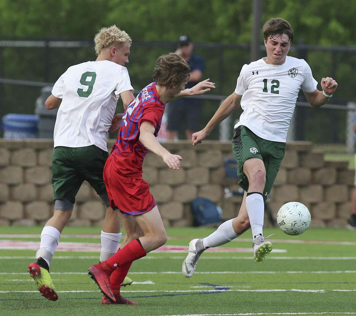 Canyon Lake's Nash Young (right) makes a pass against Midlothian Heritage's Aidan Goodman (left) during the UIL Class 4A boys high school state semifinal game in Georgetown, Texas on Wednesday, Apr. 17, 2019. Canyon Lake ended their playoff run with a 1-2 loss to Midlothian. (Kin Man Hui/San Antonio Express-News)