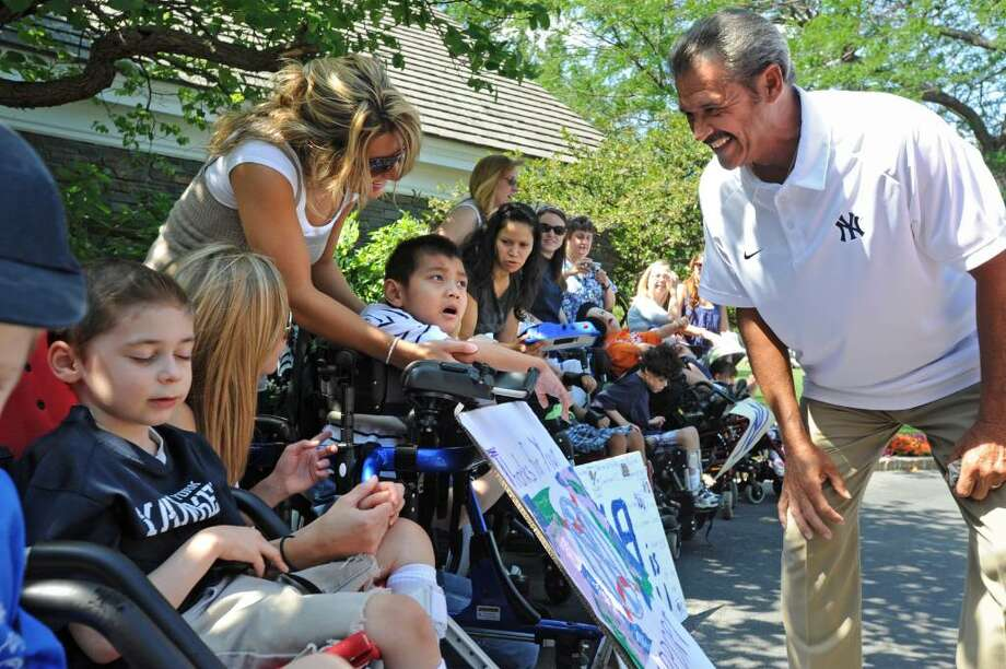 Former New York Yankee pitcher Ron Guidry greets students from the Langan School at the Center for Disability Services on the morning of the 26th Anniversary Center for Disability Services Golf Classic at Albany Country Club in Voorheesville, NY on July 26, 2010.(Lori Van Buren / Times Union) Photo: LORI VAN BUREN