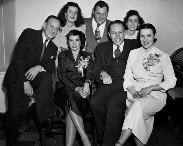 In this 1937 photo of Mayor Erastus Corning (second from right ,front row) and Dorothy (Polly) Noonan (front row, right.) Other people are unidentified. Photo taken around the time Corning was elected to State Senate. (Photo courtesy of Albany Institute of History & Art) Photo: HAND OUT / ALBANY INSTITUTE OF HISTORY &ART