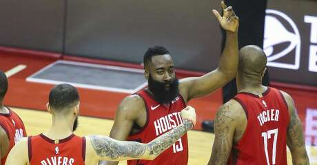 Houston Rockets guard Austin Rivers (25), guard James Harden (13) and forward PJ Tucker (17) celebrate during the first half of game 2 of the NBA playoffs at the Toyota Center in Houston, Wednesday, April 17, 2019.
