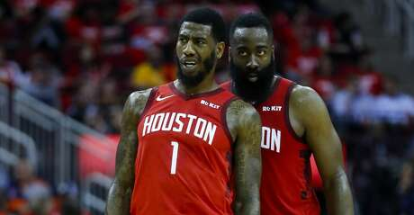 Houston Rockets guard Iman Shumpert (1) and guard James Harden (13) talk during the second half of game 2 during  the NBA playoffs at the Toyota Center in Houston, Wednesday, April 17, 2019.