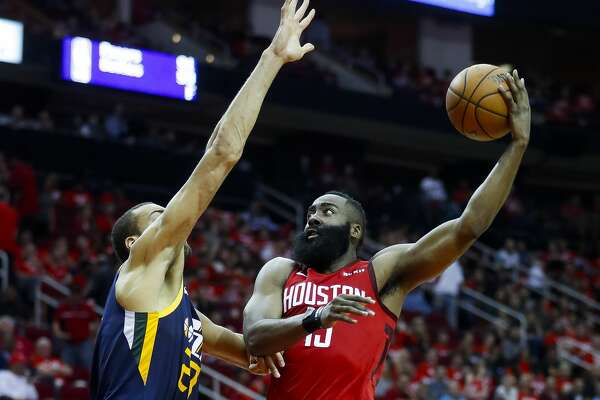 Houston Rockets guard James Harden (13) makes a move around Utah Jazz center Rudy Gobert (27) during the second half of game 2 during the NBA playoffs at the Toyota Center in Houston, Wednesday, April 17, 2019.