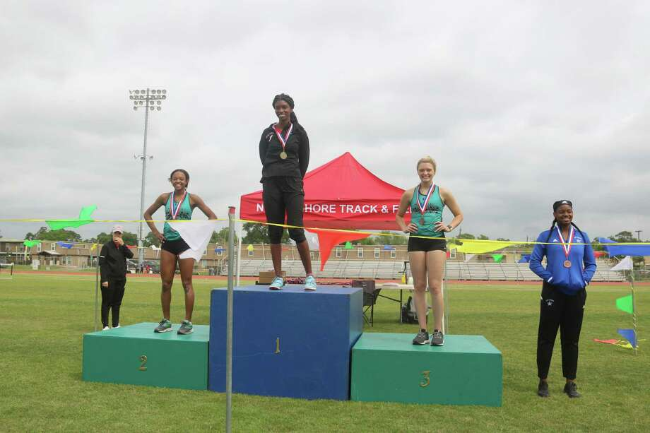 There were six different school districts represented in the triple jump, but only three on the medals stand. The Pasadena Memorial duo of Nyah Earl, left, captured second place and Brandi Hemminger, right, was third. Atascocita's Taylor Nelloms stands atop in first and fourth is Sterling's Bailee St. Romain. Photo: Robert Avery
