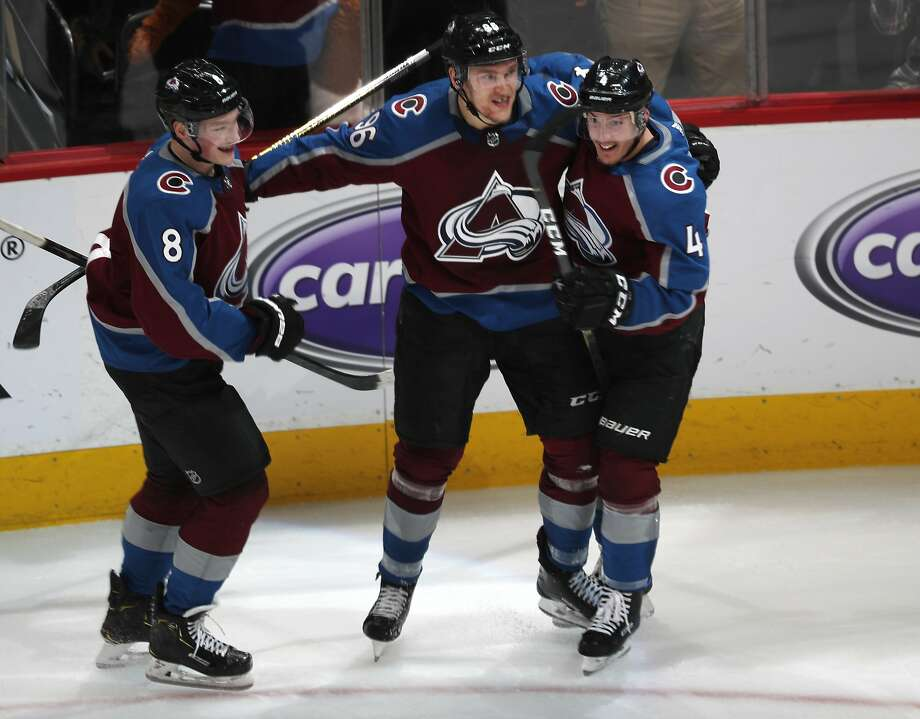 Mikko Rantanen, center, celebrates with defensemen Cale Makar (8) and Tyson Barrie (4) after scoring in OT give Colorado a 3-2 victory. Photo: David Zalubowski / Associated Press