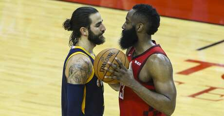 Utah Jazz guard Ricky Rubio (3) and Houston Rockets guard James Harden (13) exchange words during the second half of game 2 of the NBA playoffs at the Toyota Center in Houston, Wednesday, April 17, 2019.