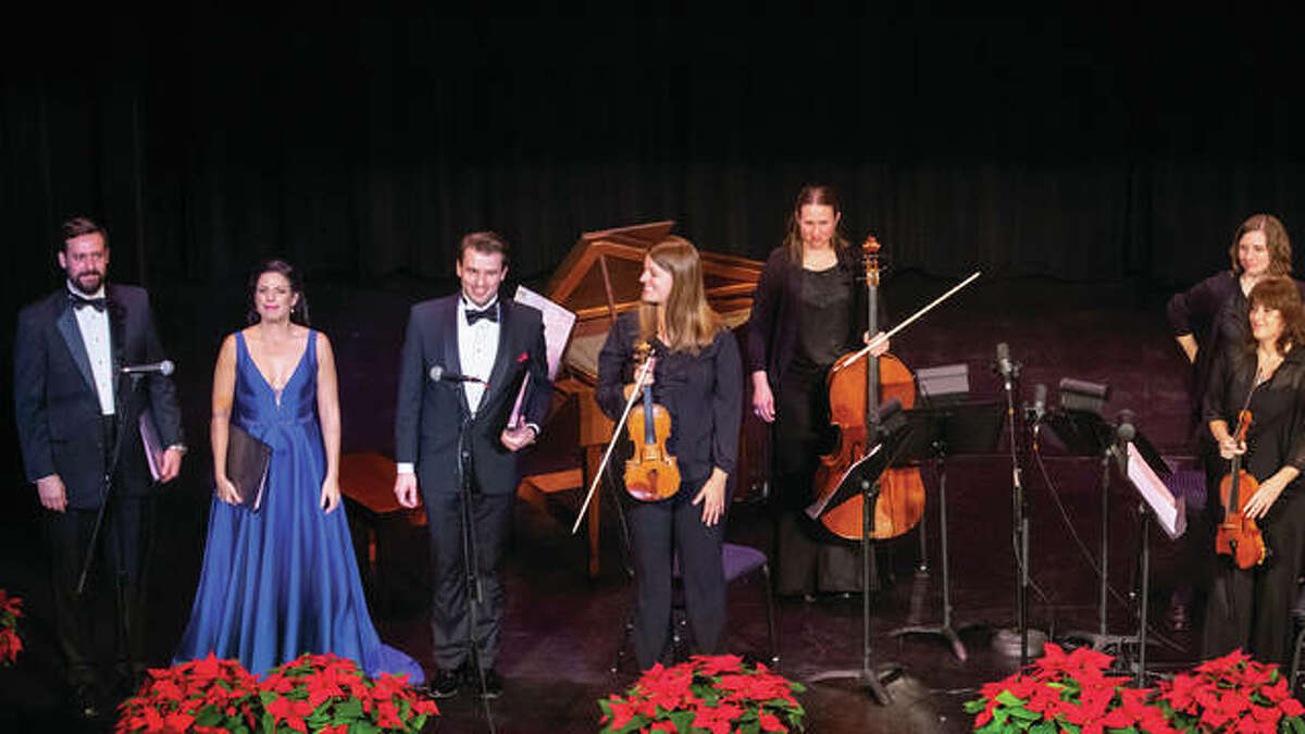 """Left to right, soloists Chase Hopkins, Sofia Troncoso, Evan Bravos and performers at Opera Edwardsville's inaugural concert, """"Christmas at the Wildey."""""""