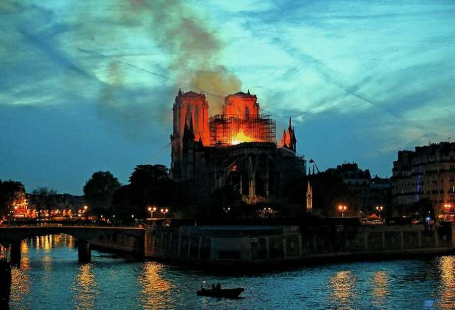 Firefighters tackle the blaze Monday as flames and smoke rise from Notre Dame cathedral in Paris. The iconic cathedral that sits at the heart of Paris has served as inspiration for all forms of art over centuries. Photo: Michel Euler | Associated Press