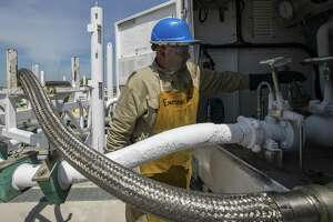Miguel Cortillo gets a tanker of liquefied natural gas ready at Stabilis Energy in George West to transport it to Laredo on Tuesday, April 2, 2019, in George West.