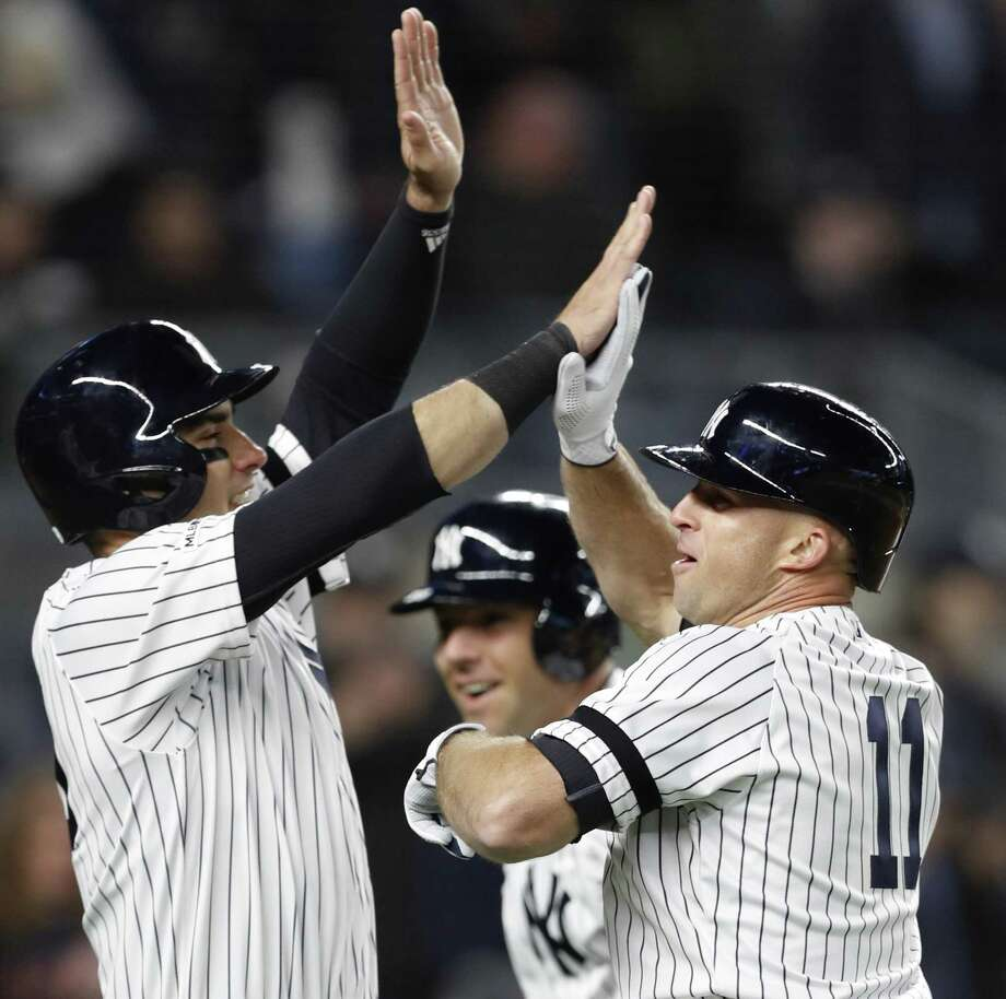 New York Yankees Brett Gardner (11) celebrates with the Yankees Mike Tauchman, left, and Austin Romine, center, after hitting a seventh-inning grand slam in baseball game against the Boston Red Sox, Wednesday, April 17, 2019, in New York. (AP Photo/Kathy Willens) Photo: Kathy Willens / Associated Press / Copyright 2019 The Associated Press. All rights reserved.