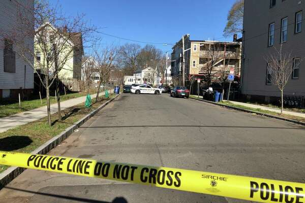 Connecticut State Police are investigating an officer-involved shooting on Dixwell Avenue in New Haven on Tuesday, April 16, 2019. Part of the road is closed because of a police investigation.