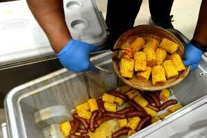 Seasoned corn for crawfish platters is dished out during the Cajun Heritage Festival held at the Carl A. Parker Multipurpose Center in Port Arthur. Plenty of Cajun favorites, including gumbo, boudin, jambalaya and boiled crawfish with sides, were available, and a number of Zydeco and Cajun bands performed.   Photo taken Saturday, April 7, 2018 Kim Brent/The Enterprise