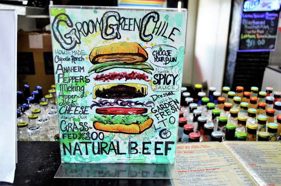 The Groovy Green Chili Burger is a specialty of locally owned Daddio's in Beaumont, Texas. The restaurant concentrates on burgers, fries and shakes. Photo: John Fulbright