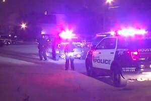 A woman was shot in the arm late Wednesday after approaching a man with Mace and a Taser in the back of an apartment complex near NRG Park, police said.