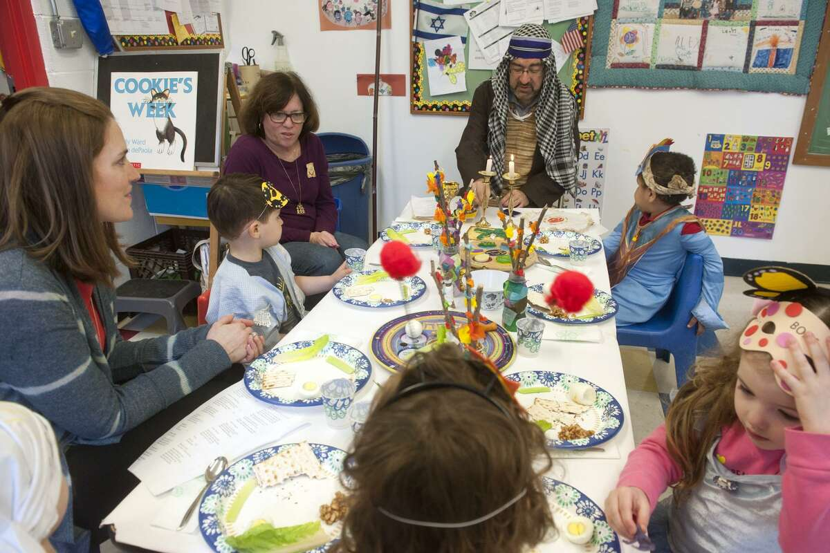 Rabbi Colin Broady, dressed as Moses, leads a Seder meal for nursery school students at Congregation B'nai Torah, in Trumbull, Conn. April 8, 2019.