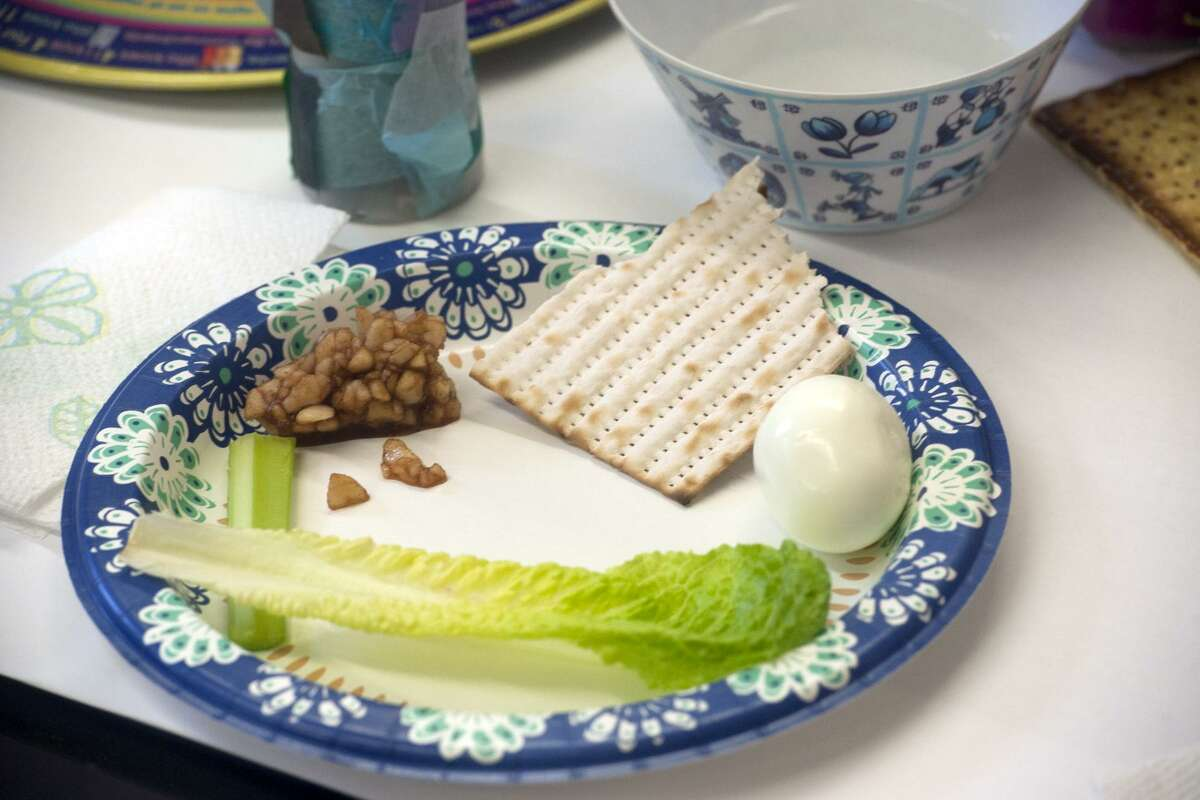 The Seder plate during a Seder meal for nursery school students at Congregation B'nai Torah, in Trumbull, Conn. April 8, 2019.