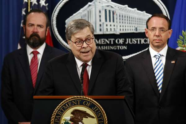Attorney General William Barr speaks alongside Deputy Attorney General Rod Rosenstein about the release of a redacted version of special counsel Robert Mueller's report during a news conference, Thursday, April 18, 2019, at the Department of Justice in Washington. (AP Photo/Patrick Semansky)