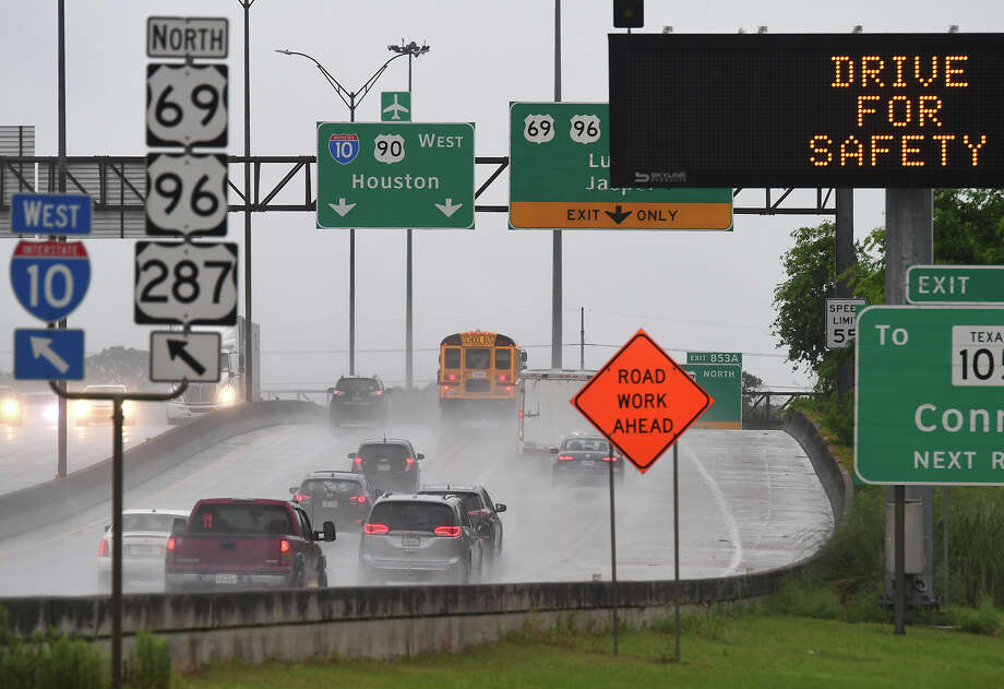 Traffic traverses rain on Interstate 10 near 11th Street Thursday morning. Friday is expected to bring clearer skies. Photo taken Thursday, 4/18/19 Photo: Drone Image: Guiseppe Barranco/The Enterprise / Guiseppe Barranco ?