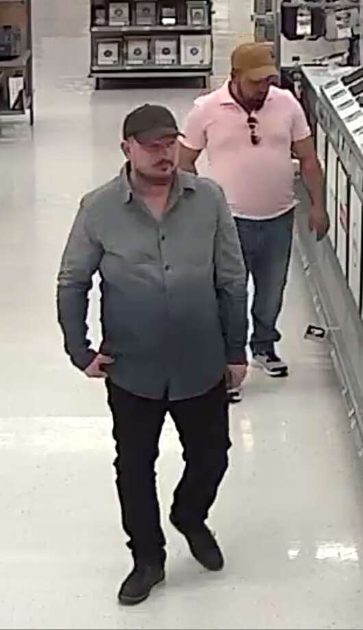 These two men allegedly stole $2,000 in cash and computers from a Rotterdam Walmart after the man on the right began dancing to distract the cashier while the other man allegedly scammed the cashier. Photo: Rotterdam Police Department