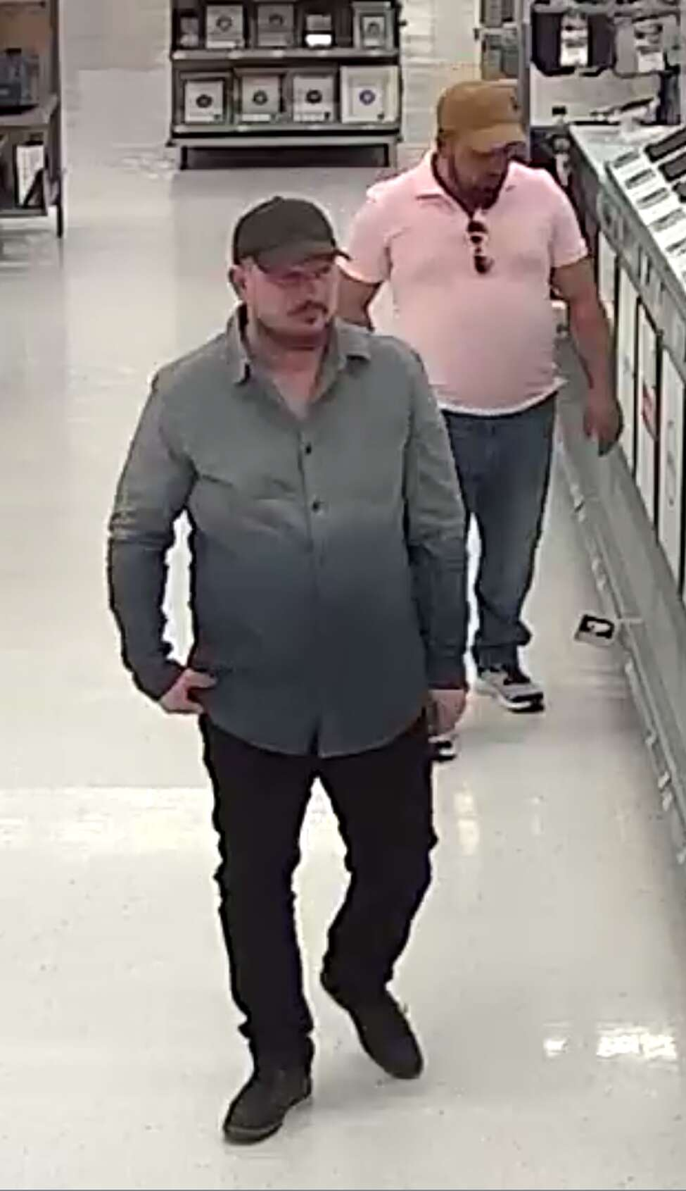 These two men allegedly stole $2,000 in cash and computers from a Rotterdam Walmart after the man on the right began dancing to distract the cashier while the other man allegedly scammed the cashier.