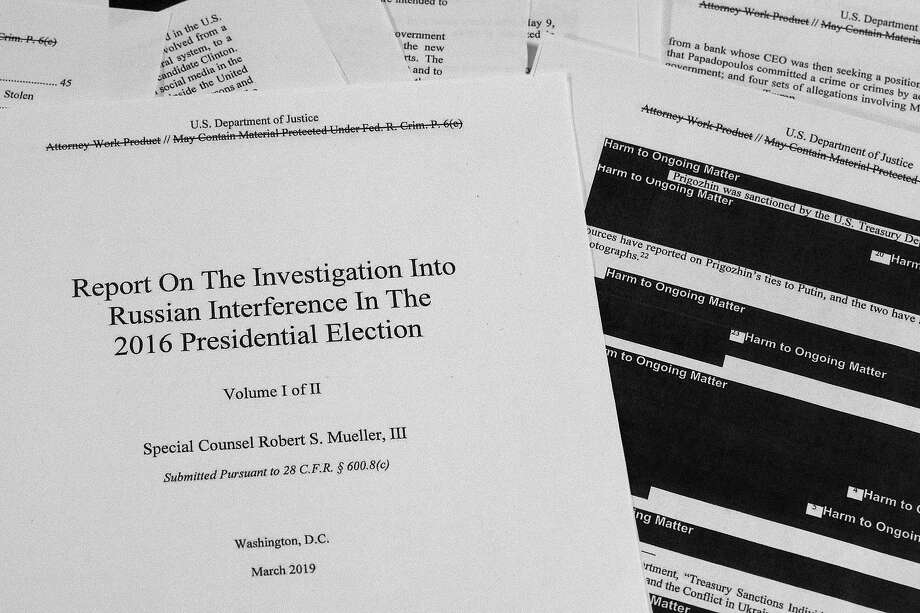 Special counsel Robert Mueller's redacted report on Russian interference in the 2016 presidential election as released on Thursday, April 18, 2019, is photographed in Washington. (AP Photo/Jon Elswick) Photo: Jon Elswick, Associated Press