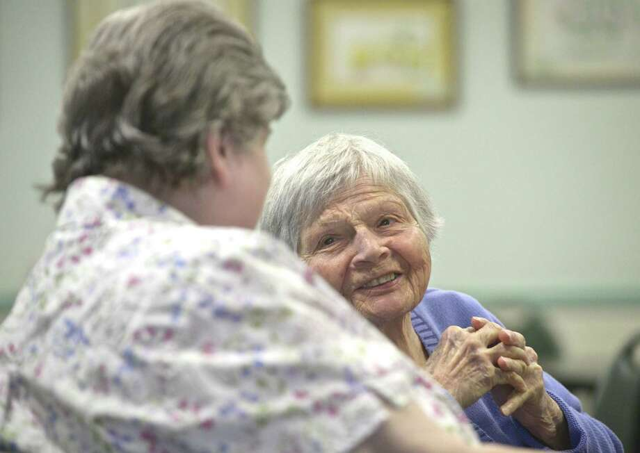 Mary Devere, right, of Sherman, talks with Esther Curley, of New Milford, at the Senior Center in New Milford. The center and the Community Culinary School of Northwestern Connecticut have teamed up to offer locally made meals to seniors. Wednesday, April 17, 2019, in New Milford, Conn. Photo: H John Voorhees III / Hearst Connecticut Media / The News-Times