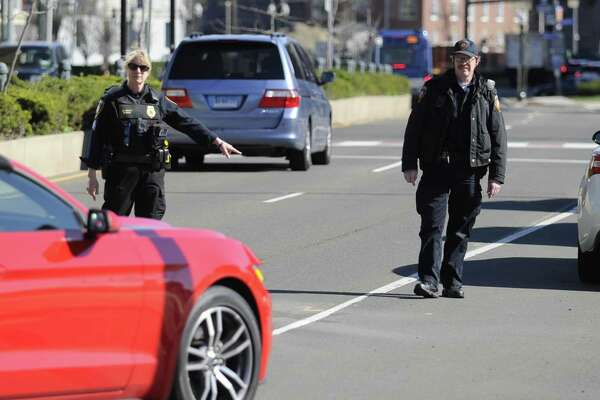 Sgt. Jennifer Pinto of the Stamford Police Department and Police Officer Thomas Drain conduct a traffic stop on Washington Blvd. Tuesday, April 16, 2019 in Stamford, Connecticut. Pinto and a team of city traffic officers were citing distracted drivers as part of a national U Drive, U Text, U Pay, high-visibility enforcement effort. April is National Distracted Driving Awareness Month.