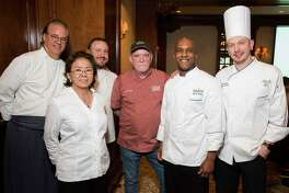 EMBARGOED FOR REPORTER UNTIL FRIDAY APRIL 19 Chefs Robert Del Grande, of Cafe Annie, from left, Nga Rogers, of Pâtisserie Paris Je T'aime, Neal Cox, of TRIBUTE, Mark Schmidt, of Rainbow Lodgepose, Elliott Kelly, of Cafe Annie, and Donovan Wood, of Steak 48, pose for a photograph at 19th Annual Chef's Dinner at Houstonian Hotel on Wednesday, April 17, 2019, in Houston.