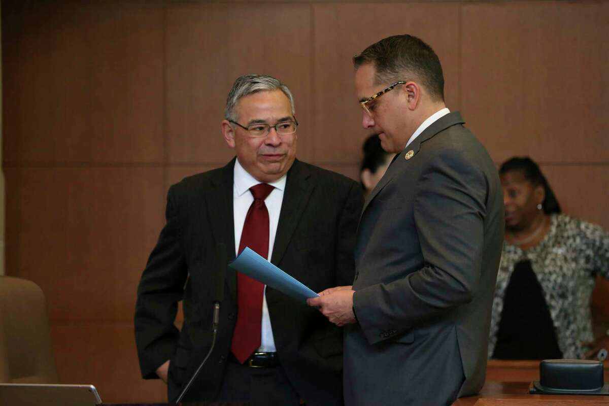 San Antonio City Councilmember Greg Brockhouse, right, speaks with City Attorney Andy Segovia before the start of a regular council meeting, Thursday, April 18, 2019. Brockhouse proposed a procedural move revisiting a contract that excluded Chick-fil-A restaurant from operating at the San Antonio International Airport. The council voting against the move.
