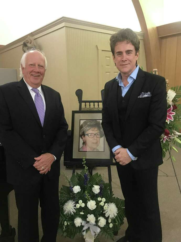 Conroe Symphony Orchestra conductor, Dr. Don Hutson, left and Broadway musician Sal Vivano, right, stand on either side of a picture of Dr. Aline Arnold at a memorial service for her on April 6 at the Conroe Symphony Centre. Dr. Arnold was the executive director for the CSO. She passed away in February. Photo: Courtesy Photo