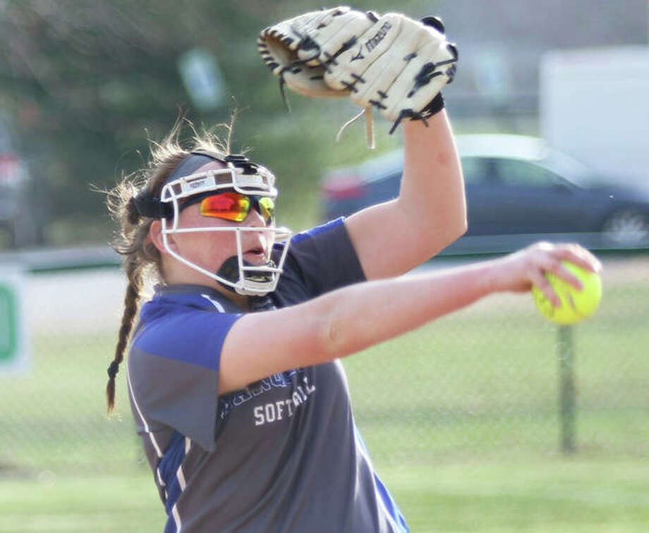 Marquette Catholic's Taylor Whitehead took a no-hitter to the 12th inning, but three walks and a grand slam enabled Hillsboro to beat the Explorers 4-0 in 12 innings at Moore Park in Alton. She is shown pitching earlier this season. Photo: Greg Shashack / The Telegraph