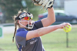 Marquette Catholic's Taylor Whitehead took a no-hitter to the 12th inning, but three walks and a grand slam enabled Hillsboro to beat the Explorers 4-0 in 12 innings at Moore Park in Alton. She is shown pitching earlier this season.