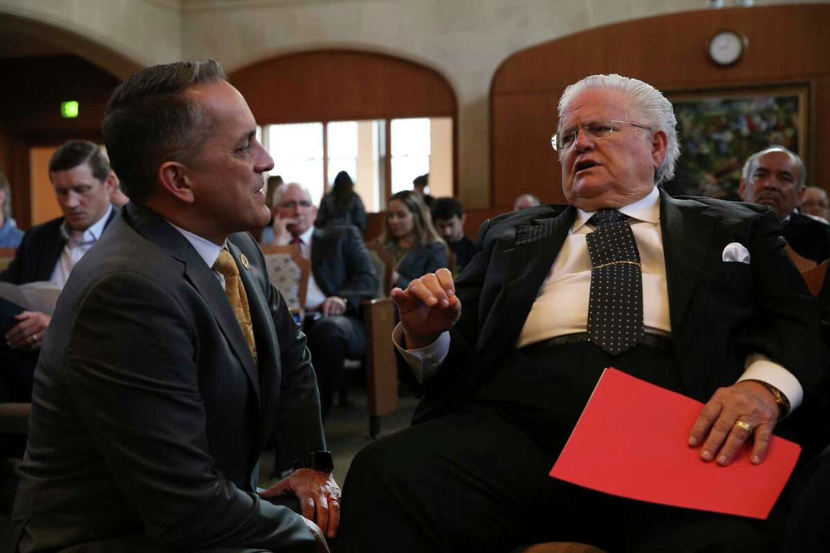 San Antonio City Councilmember Greg Brockhouse, left, speaks with Cornerstone Church Pastor John Hagee before the start of a regular council meeting, Thursday, April 18, 2019. Brockhouse proposed a procedural move revisiting a contract that excluded Chick-fil-A restaurant from operating at the San Antonio International Airport. Several pastors were on hand in support of the move. The council voted against the move.