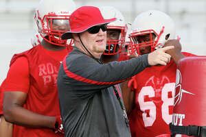 Judson head coach Sean McAuliffe works with the defensive linemen during a morning practice at the school on Tuesday, Aug. 14, 2018.