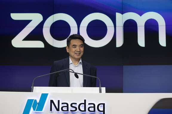 Zoom CEO Eric Yuan attends the opening bell at Nasdaq as his company holds its IPO, Thursday, April 18, 2019, in New York. The videoconferencing company is headquartered in San Jose, California. (AP Photo/Mark Lennihan)