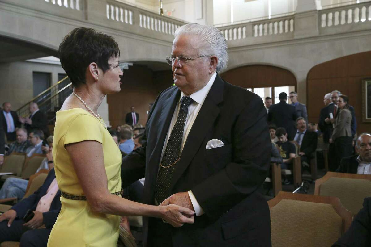 """Texas State Sen. Donna Campbell, (R-New Braunfels), greets Cornerstone Church Pastor John Hagee before the start of a regular city council meeting, Thursday, April 18, 2019. They attended the meeting in support of a proposal by Councilman Greg Brockhouse revisiting a controversial decision last month to remove Chick-fil-A from an airport contract because of its ?'legacy of anti-LGBTQ behavior.?"""" The council voted against the proposal."""