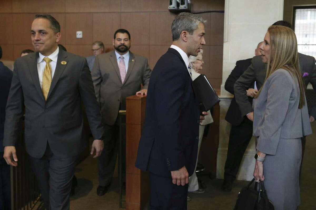 San Antonio Mayor Ron Nirenberg, center, and City Council member Greg Brockhouse, left, mingle with the public before the start of a regular council meeting, Thursday, April 18, 2019. Brockhouse proposed revisiting a contract that excluded Chick-fil-A restaurant from operating at the San Antonio International Airport. The council voted against the move.