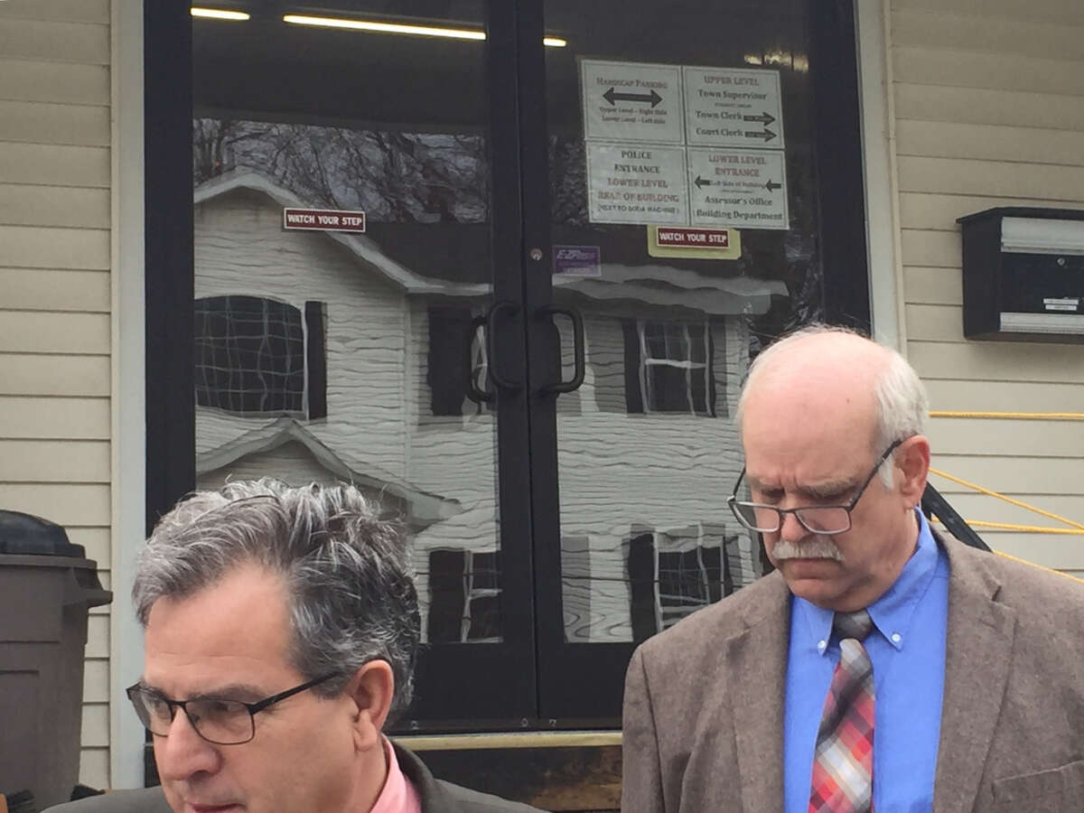 Former state Office of Mental Health supervisor John Allen walks behind his attorney, Kevin Luibrand, following an appearance in Coeymans Town Court on Thursday, April 18.