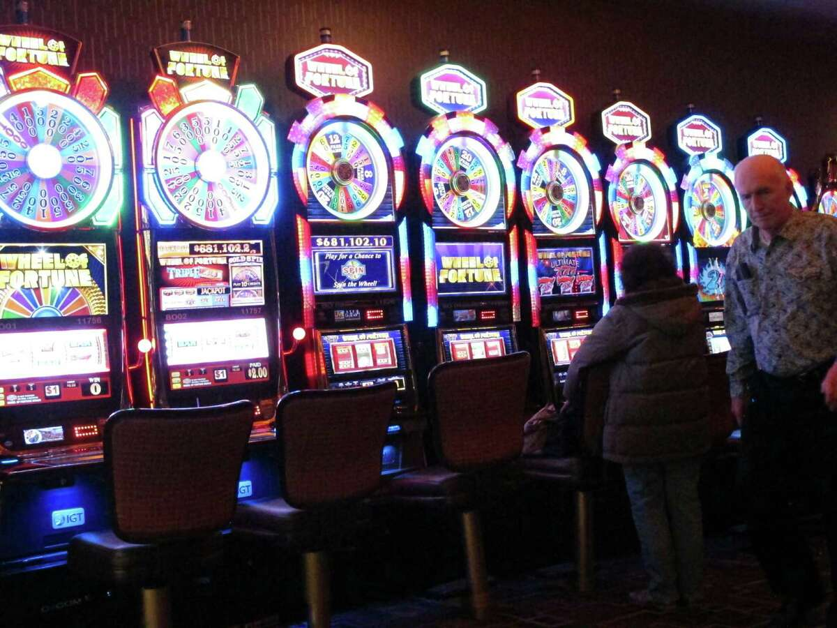 This Feb. 22, 2019, photo shows gamblers playing slot machines at the Golden Nugget casino in Atlantic City, N.J.