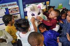 Preschool children gather around as the Spring Bunny visited the children at Unity House?•s A Child?•s Place in celebration of springtime on Thursday, April 18, 2019, in Albany, N.Y. The children had their photo taken with the Spring Bunny and received a book. (Paul Buckowski/Times Union)