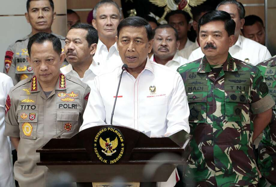 """Security Minister Wiranto says officials will """"act decisively"""" against any attempt to disrupt public order. Photo: Dita Alangkara / Associated Press"""