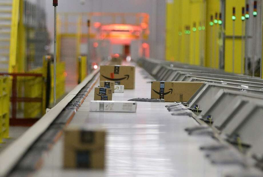 Packages move through the shipping sorter at the Amazon HOU2 Fulfillment Center, 10550 Ella Blvd., Thursday, Sept. 6, 2018, in Houston. Photo: Melissa Phillip / Staff Photographer / © 2018 Houston Chronicle