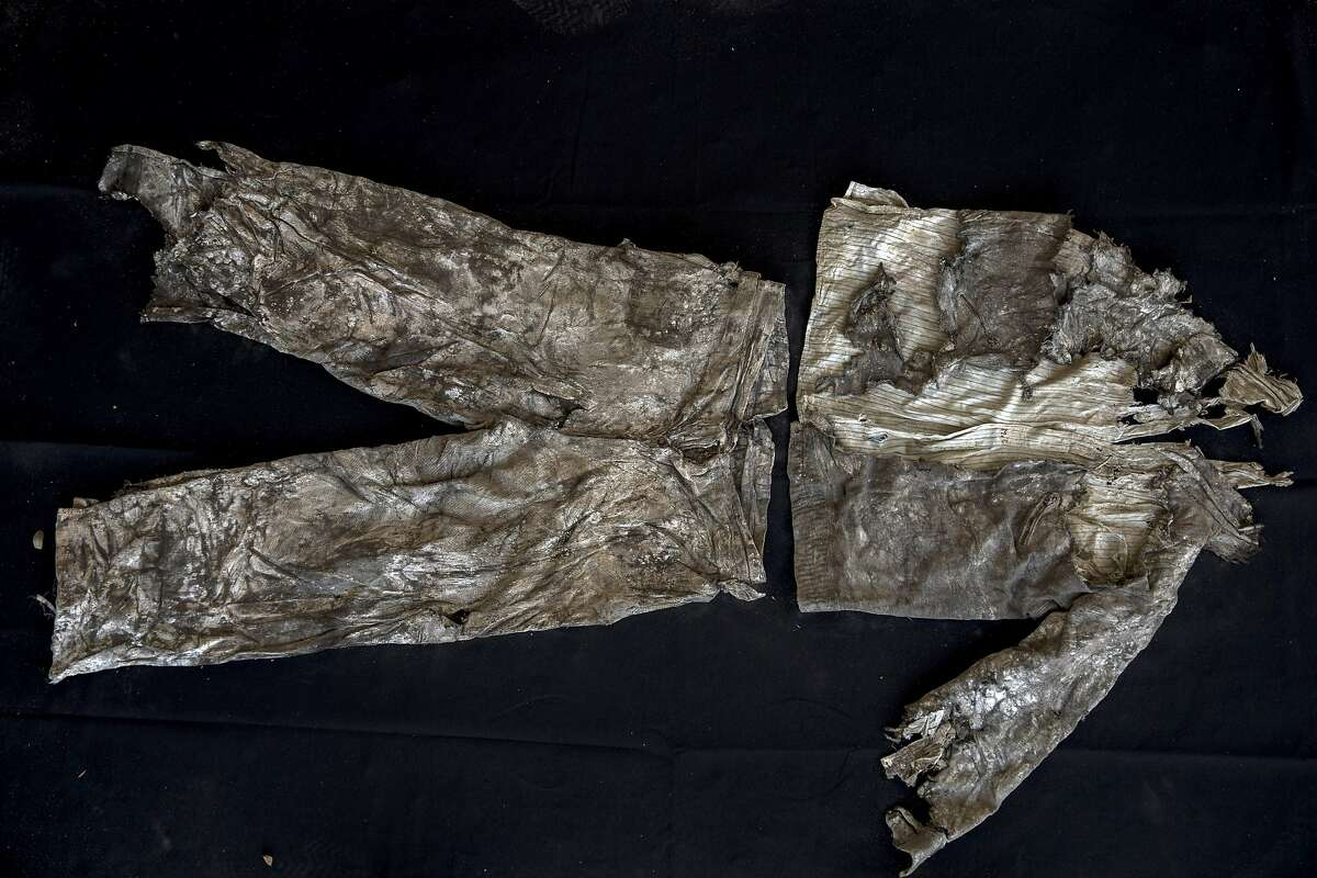 """In this Thursday, March 26, 2019 photo, the clothes of a victim with monogram 'MG"""" embroidered into the shirt, photographed after the body was exhumed from a mass grave at the cemetery of Paterna, near Valencia, Spain, after archaeologists in Spain unearthed layers of human bones last year. DNA tests will be conducted in the hope of confirming the identities of those who disappeared eight decades ago, believed to be executed by the forces of Gen. Francisco Franco during and after the 1936-39 Spanish Civil War.(AP Photo/Emilio Morenatti)"""