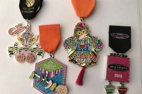 """FIESTA Medals 2019 �"""" top winners (left to right): Queen of Conchas by Karolina's Antiques (Best in Show overall and First Place: Retailers); Firstmark Credit Union (First runner-up overall and First Place: Food Treats); monkey toy medal by David Durbin (Tie for Second runner-up overall and First Place: Individual); Taco Cabana (tie for Second runner-up overall and First Place: Restaurants)."""