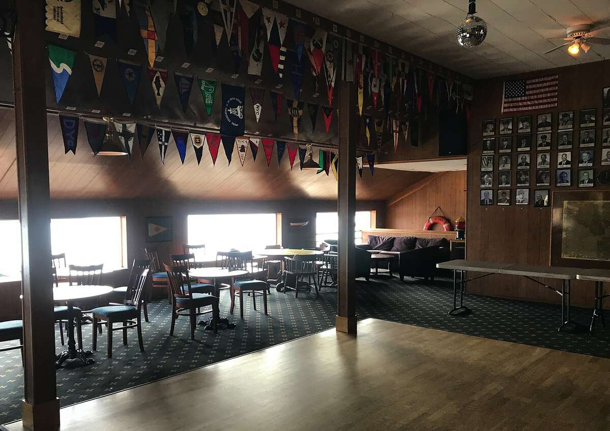 Low-slung windows at Presidio Yacht Club cut off the vies
