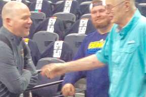 Denver Nuggets coach Michael Malone shares a moment with former Nuggets coach Doug Moe on Thursday, April 18, at the AT&T Center.