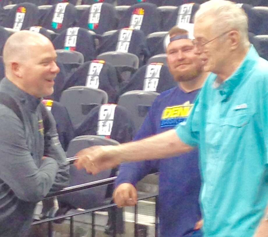 Denver Nuggets coach Michael Malone shares a moment with former Nuggets coach Doug Moe on Thursday, April 18, at the AT&T Center. Photo: Tom Orsborn/Staff