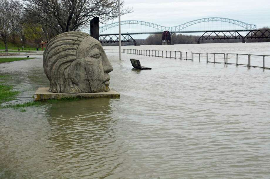 The Connecticut River has been rising since Tuesday as the spring freshet began, submerging the boardwalk at Harbor Park in Middletown. Thursday afternoon, water had reached the pedestal of the Wangunk sculpture, whose gaze is directed toward the Portland side of the river. Photo: Cassandra Day / Hearst Connecticut Media