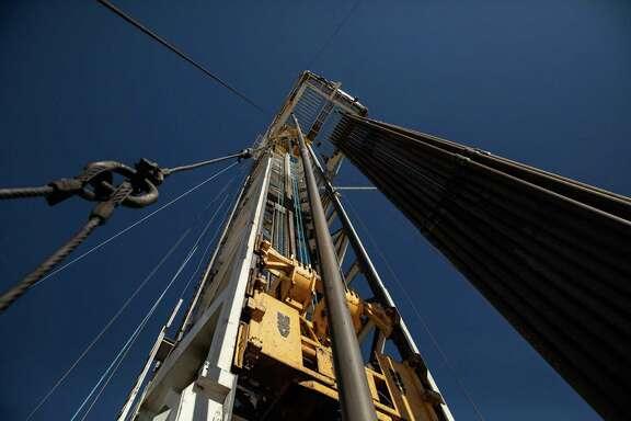 An oil drilling rig on a Parsley Energy facility near Midland, Texas.